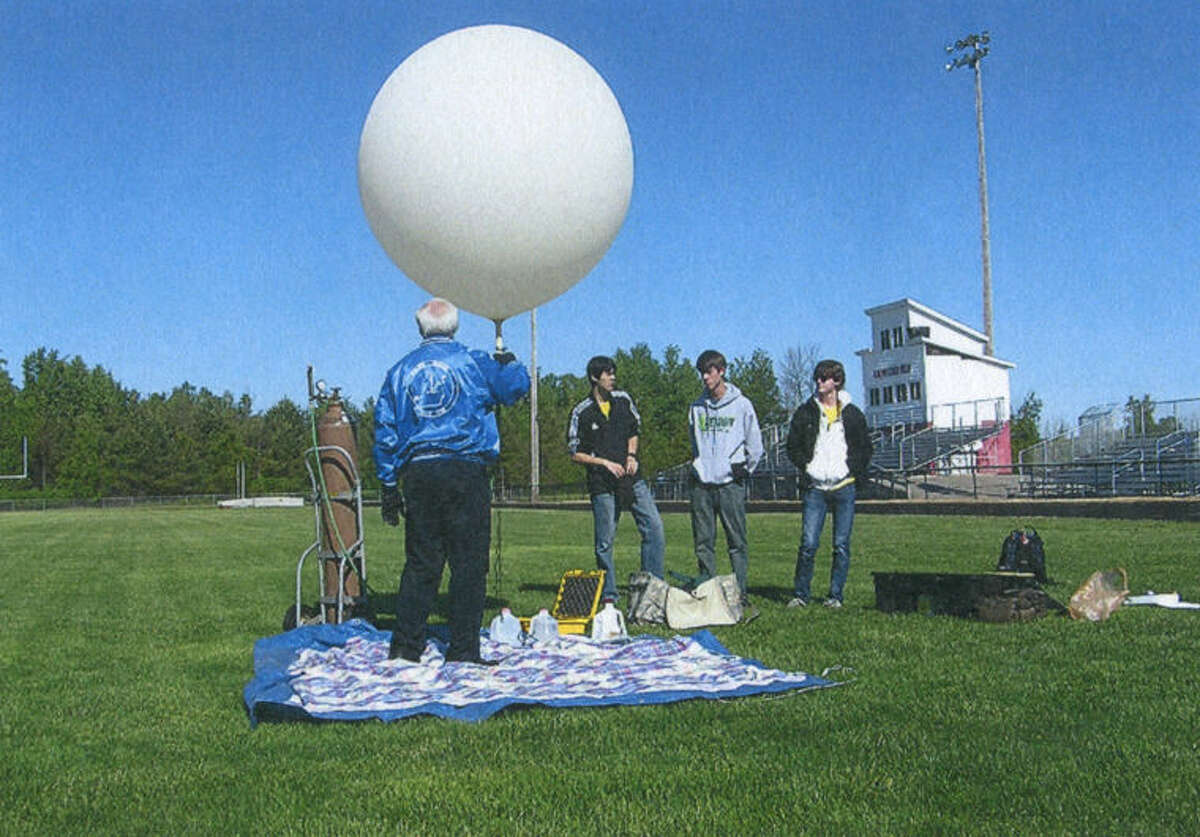 The balloon is about to be launched from the Beaverton High School football field.