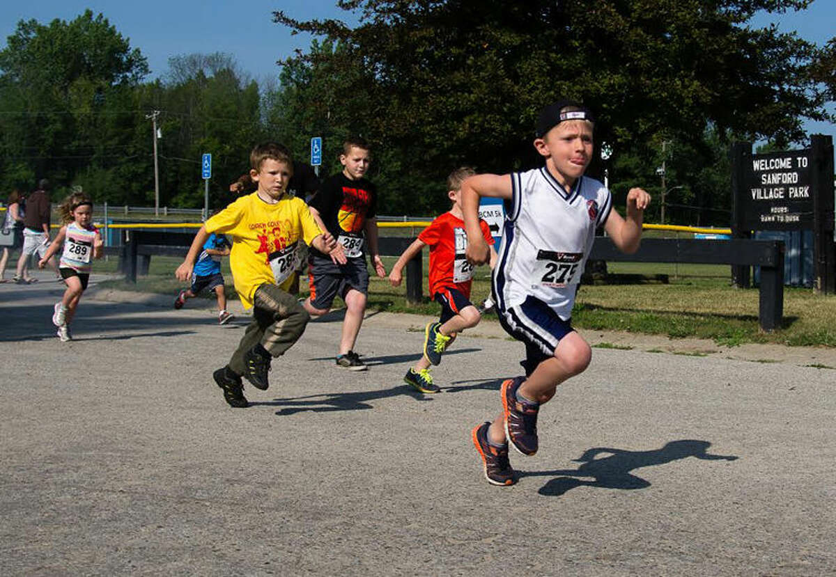 Some of the Tot Trot participants head toward the finish line in Sanford Saturday. TheTot Trot was held after the fifth annual Coach Cole Memorial 5K walk/run.