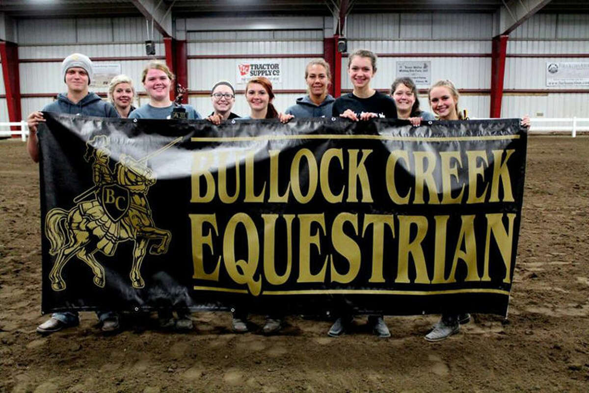 The Bullock Creek Equestrian Club, headed to the state finals, includes (from left) Nate Wallace, assistant coach Maddie Hays, Jayci Cain, assistant coach Mikaela Backus, McKenna Wisniewski, head coach Melanie Blues, Avery Jaster, assistant coach Amber Wallace, Reegan Carey. Not pictured are riders Shay Bonham, Raeleen Backus, and Sydney Smith.