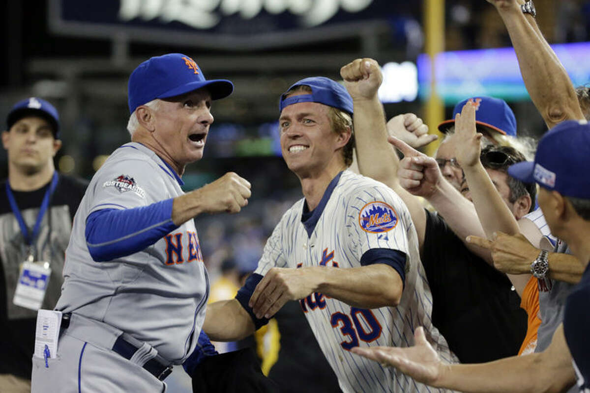 New York Mets manager Terry Collins, left, celebrates the Mets' 3-2 win over the Los Angeles Dodgers in Game 5 of Thursday's National League Division Series Thursday, in Los Angeles. Collins, 66, grew up in Midland and graduated from Midland High School in 1967.