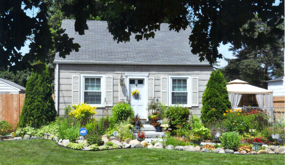 This house on Jefferson is a past beautification recipient. Photo: Photo Provided