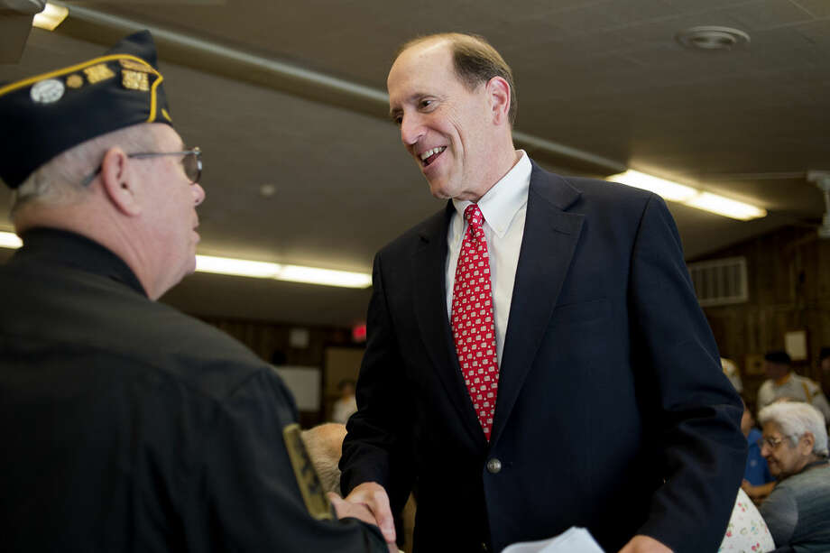 U.S. Congressman Dave Camp is greeted by American Legion Post 404 Commander Joseph Prato Jr. before a medal ceremony in Harrison in October 2014.