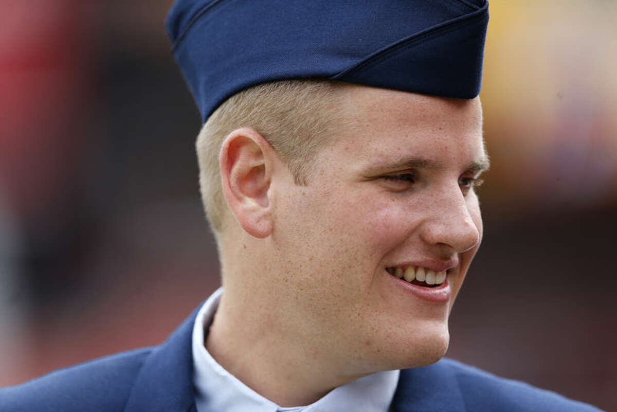 FILE - In this Sept. 20, 2015 file photo, US Air Force Airman 1st Class Spencer Stone walks along the sidelines before an NFL football game in Landover, Md. An Air Force spokesman said Thursday, Oct. 8, 2015, that Stone, who helped subdue an attacker on a Paris-bound train in August, is in stable condition after being stabbed in California. (AP Photo/Patrick Semansky, File)