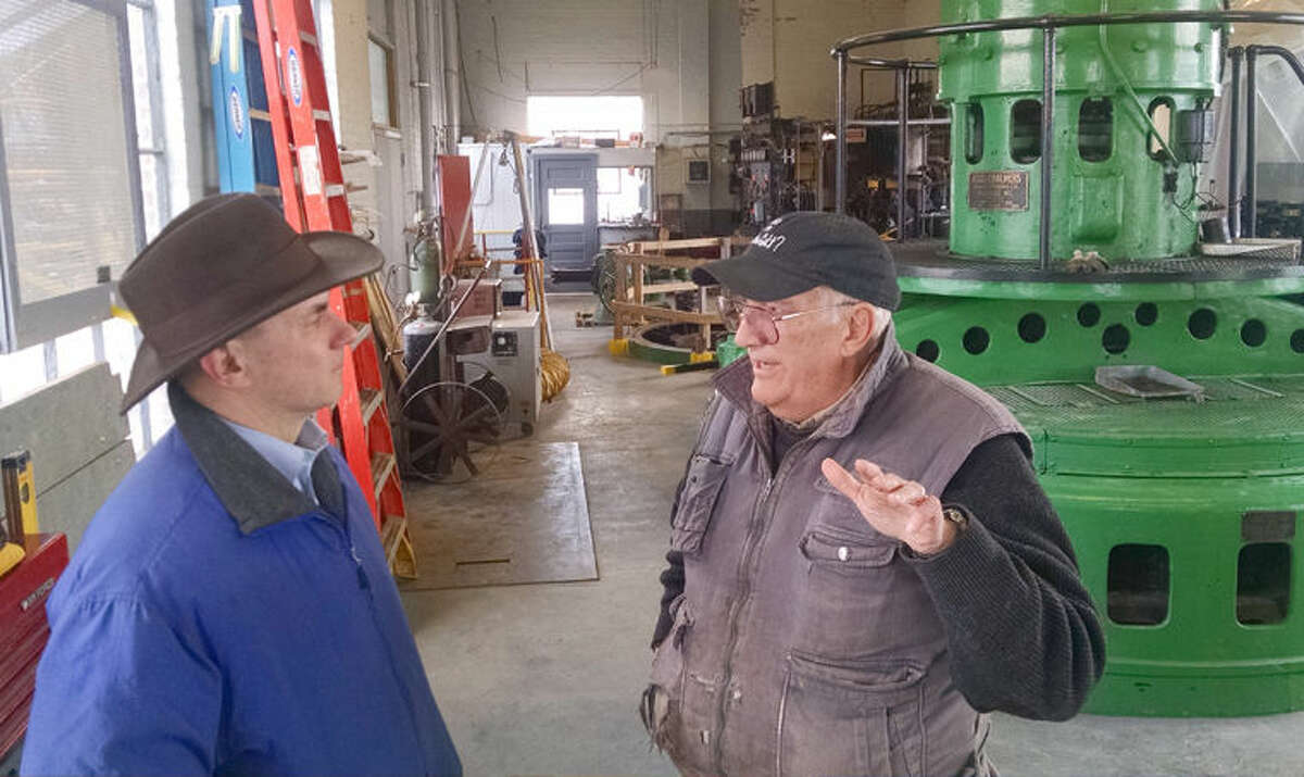 Lee W. Mueller, right, architect and co-member manager of Boyce Hydro LLC, which operates Sanford Dam, talks with state Rep. Gary Glenn, R-Midland, vice chair of the House Energy Policy Committee.