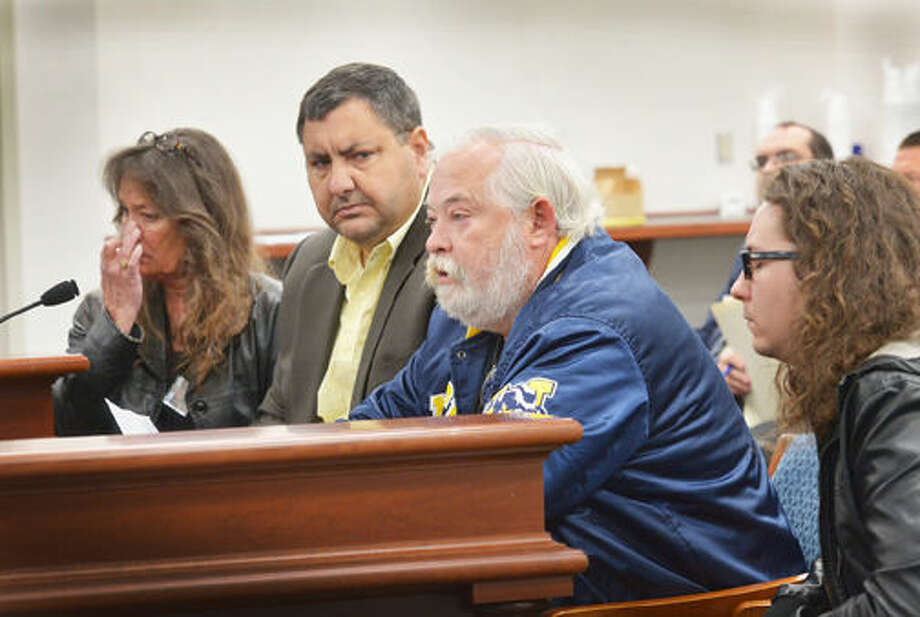 "The family of U.S. Navy Corpsman Aaron Ullom joined state Sen. Jim Stamas, R-Midland, to testify in support of Stamas' legislation to permanently honor Ullom by designating the bridge on U.S. 10 over Eastman Avenue in Midland as the ""Corpsman Aaron D. Ullom Memorial Bridge."" Pictured, from left, are Ullom's mother Debi Ullom, Stamas, Ullom's father Kevin Ullom and step-brother Sean Bartley."