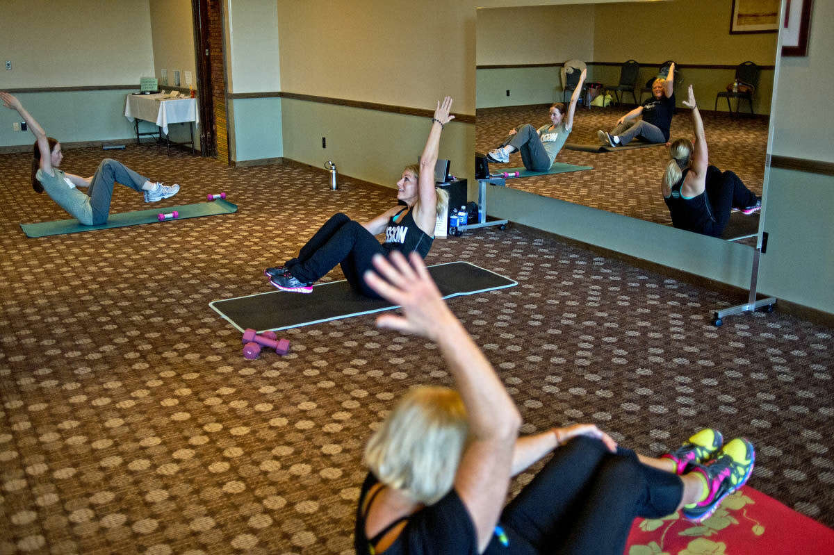 Renee Gerulski leads a workout class at her newly opened Mission Fitness in Midland.