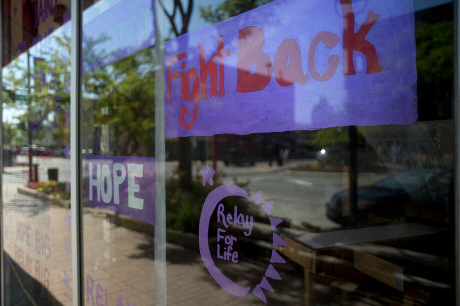Grape Beginnings Winery is the 2015 Paint the Town Purple Award winner. Grape Beginnings painted the store front window to raise awareness for this weekend's Relay For Life of Midland County event. Photo: Brittney Lohmiller | Blohmiller@mdn.net