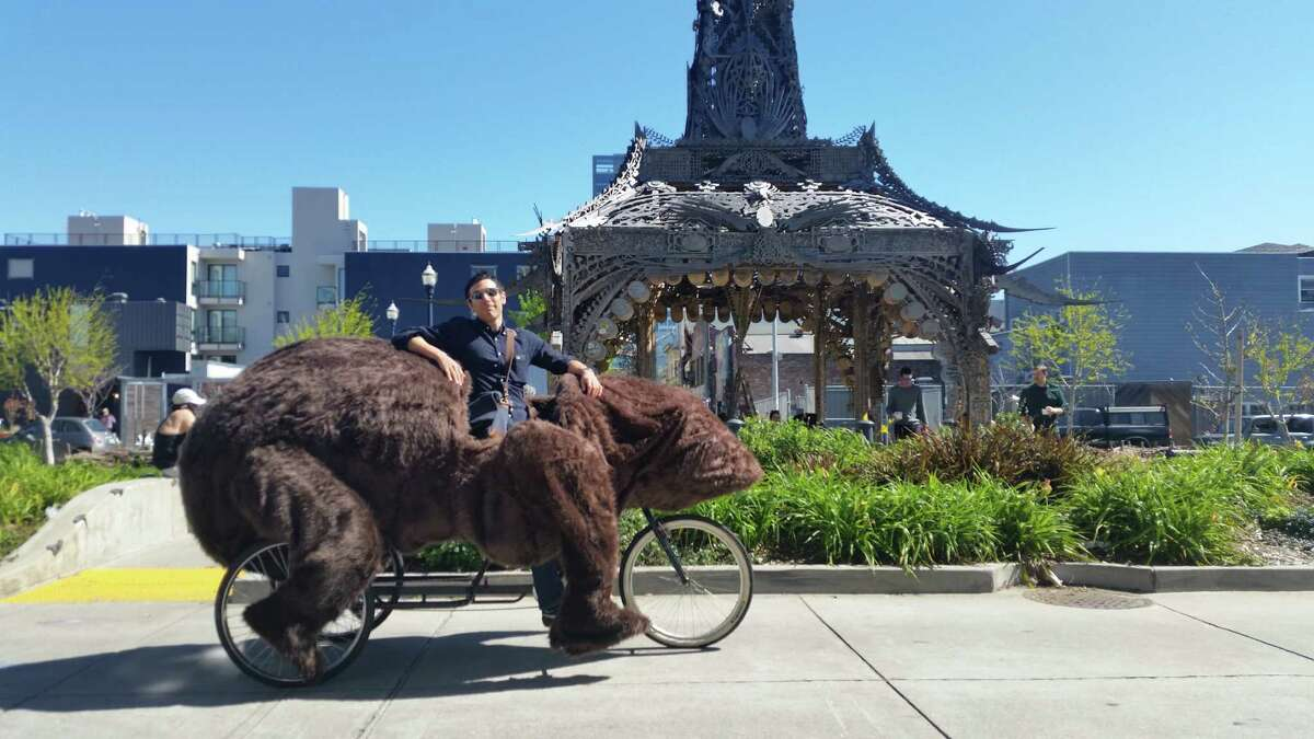 Dave Eggers created this bear pedicab that appeared in a recent Hayes Valley exhibition of his artwork. As we found out, riding it gets you a fair amount of attention.