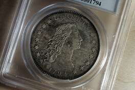 freemoney270100.jpg Event on 7/26/05 in San Francisco. A very rare 1794 U.S. silver dollar, one of only an estimated 120-130 in existence, will be on display this week at the Rare Coin Wholesalers booth in the World's Fair of Money at Moscone Center West. The event runs through Sunday. According to Donn Pearlman, spokesperson for the fair, visitors will be able to see a billion dollars, without it costing a cent. Chris Stewart / The Chronicle