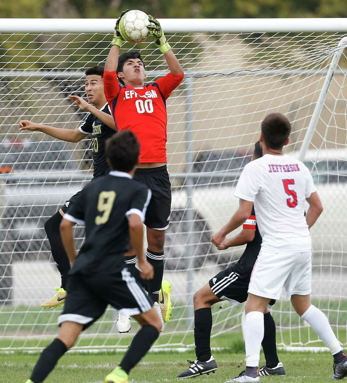 Jefferson goalkeeper Miguel Del Fierro makes a save against Edison's Livan Hernandez (20) in a boys soccer match to determine the District 28-5A championship title at SAISD Spring Sports Complex on Thursday, Mar. 17, 2016. Jefferson won the title but both teams will head into playoffs. The Mustangs defeated the Bears, 4-1. (Kin Man Hui/San Antonio Express-News)