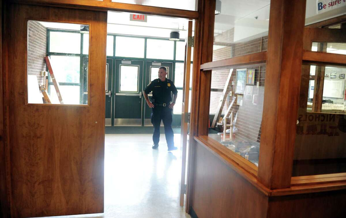 Deputy Police Chief Joseph McNeil checks out the new security doors at Nichols School in Stratford, Conn., Thursday, Aug. 21, 2014. A second set of doors adds another layer of security to the building.
