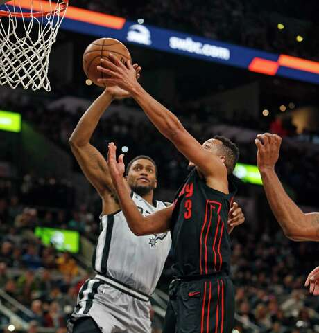 Portland Trail Blazers shooting guard C.J. McCollum (3) has his shot blocked by San Antonio Spurs forward Rudy Gay (22) during the first half of an NBA basketball game Saturday, April 7, 2018, in San Antonio. (AP Photo/Ronald Cortes) Photo: Ronald Cortes, Associated Press / ap