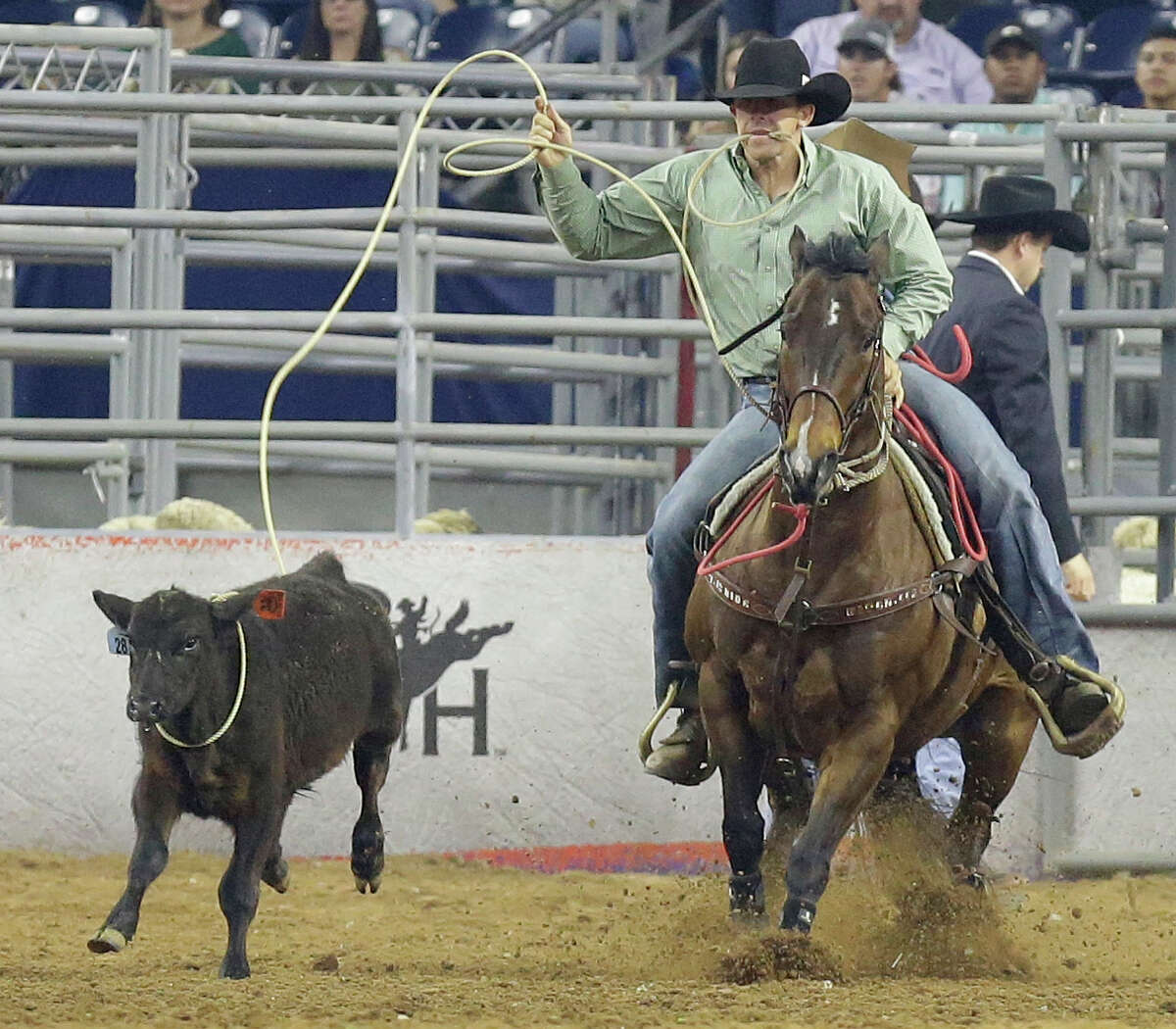 Ryle Smith of Oakdale, CA competes in tie-down roping at RodeoHouston during the Houston Livestock Show and Rodeo in NRG Stadium Thursday, March 17, 2016, in Houston.