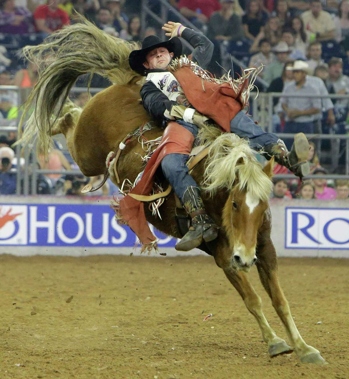 Mason Clements of Sandy, UT competes in bareback riding at RodeoHouston during the Houston Livestock Show and Rodeo in NRG Stadium Thursday, March 17, 2016, in Houston.