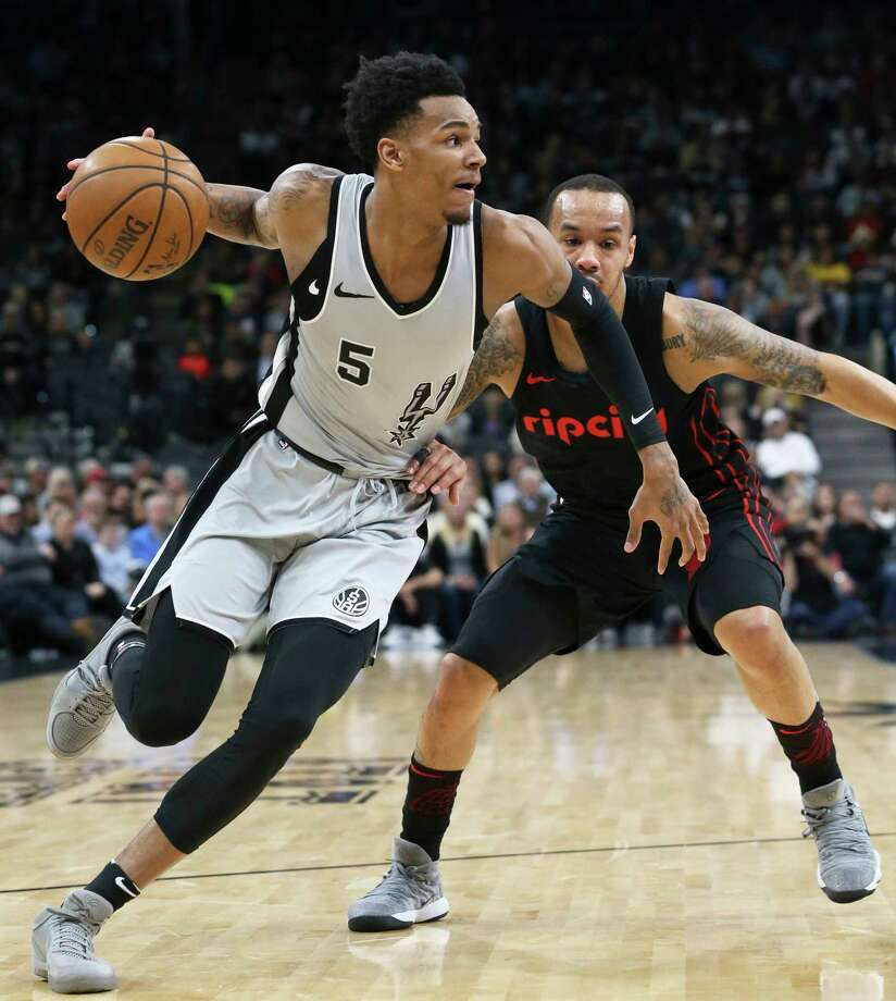 Dejounte Murray turns the corner into the lane as the Spurs play the Portland Trailblazers at the AT&T Center on April 7, 2018. Photo: Tom Reel, San Antonio Express-News / 2017 415916Z.1 ANTONIO EXPRESS-NEWS