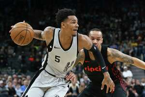 Dejounte Murray turns the corner into the lane as the Spurs play the Portland Trailblazers at the AT&T Center on April 7, 2018.