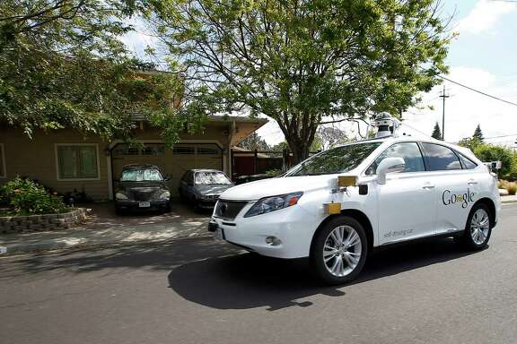 A Google self-driving Lexus cruises along a Mountain View, Calif., street last year during a demonstration drive. The technology giant is hinting that self-driving technology could be ready for early adopters sooner than expected.