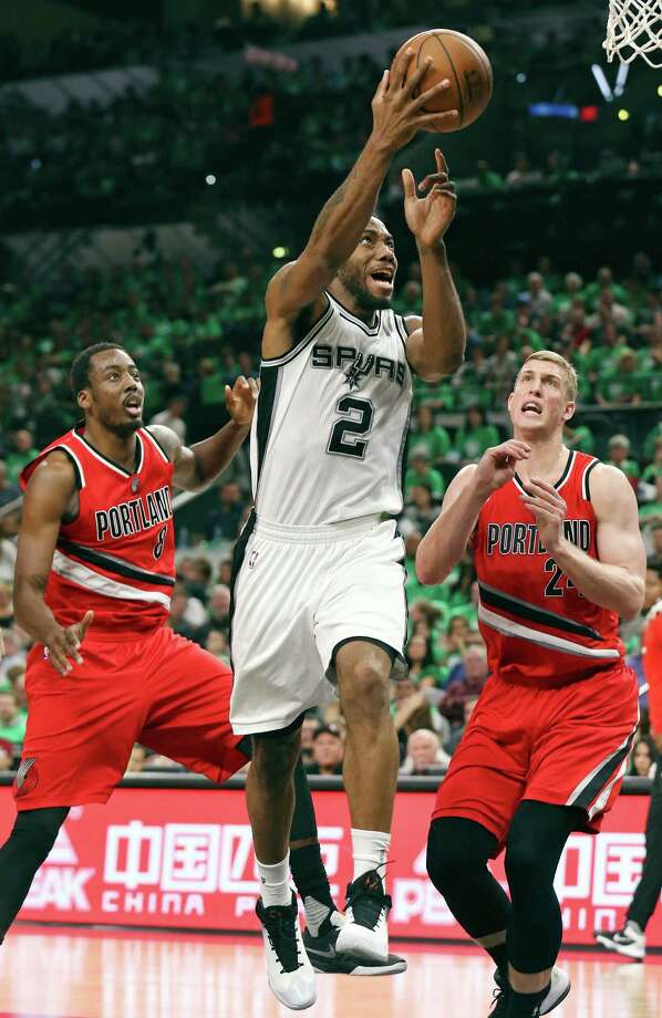 San Antonio Spurs' Kawhi Leonard shoots between Portland Trail Blazers' Al-Farouq Aminu (left) and Mason Plumlee during second half action Thursday March 17, 2016 at the AT&T Center. The Spurs won 118-110. Photo: Photos By Edward A. Ornelas / San Antonio Express-News / © 2016 San Antonio Express-News