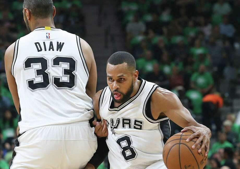 Patty Mills slips around a screen by Boris Diaw as the Spurs host the Blazers at the AT&T Center on March 17, 2016. Photo: Tom Reel /San Antonio Express-News / 2016 SAN ANTONIO EXPRESS-NEWS