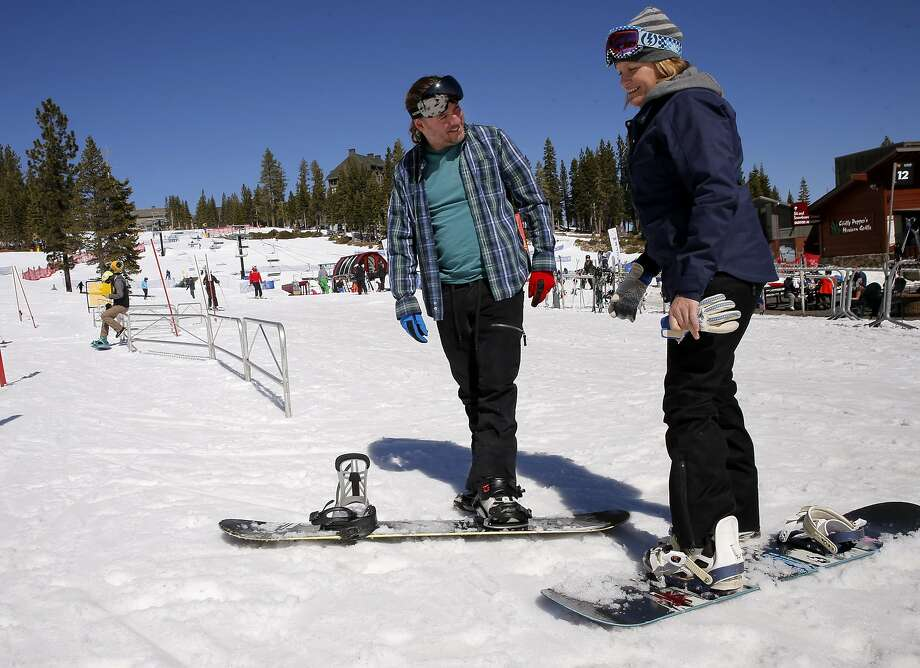 Eric Whatley and Annie Tuft of Auburn get set to take off on their 50th day of snowboarding this season at Northstar California Resort in Truckee. Tahoe-area businesses are seeing a rebound with the huge snowfall. Photo: Michael Macor, The Chronicle