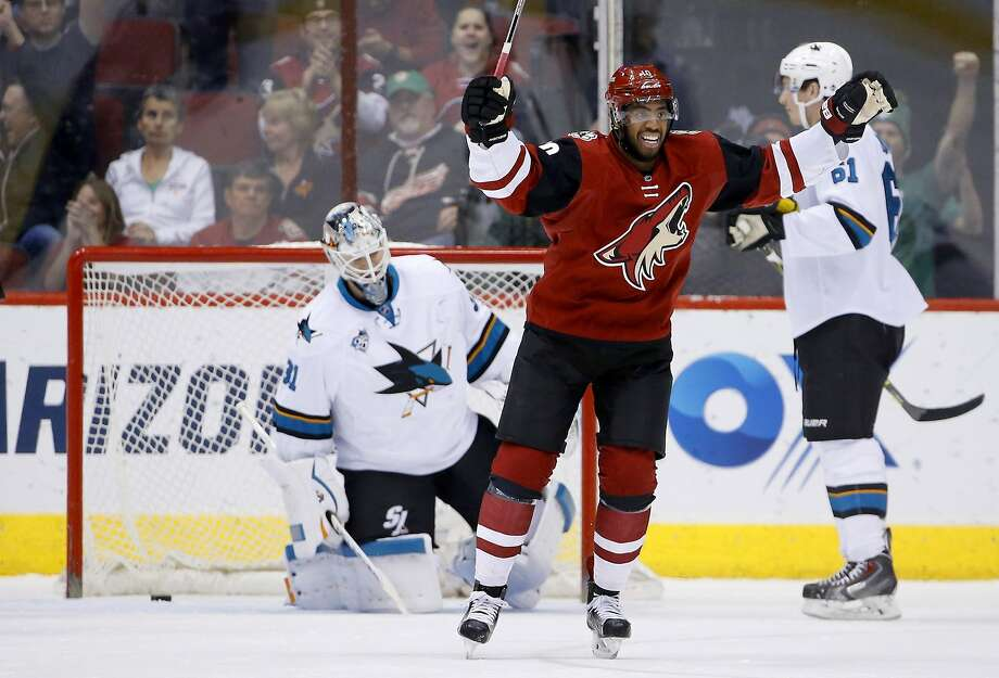 Arizona Coyotes' Anthony Duclair, front, smiles as he goes to celebrate a goal scored by Michael Stone against San Jose Sharks' Martin Jones, left, as Sharks' Justin Braun, right, looks on during the first period of an NHL hockey game Thursday, March 17, 2016, in Glendale, Ariz. (AP Photo/Ross D. Franklin) Photo: Ross D. Franklin, AP