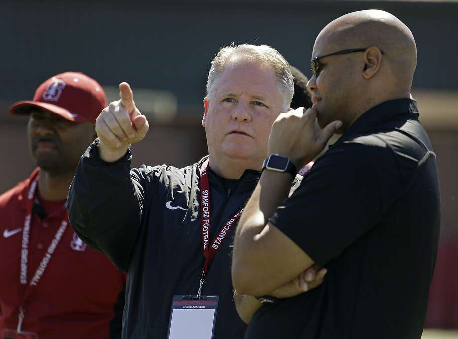Chip Kelly speaks with Stanford's David Shaw during Stanford's pro day on Thursday. Photo: Ben Margot, AP