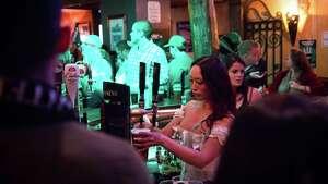 A bartender serves drinks at Fadó Irish Pub on St. Patrick's Day, Thursday, Mar. 17, 2016.