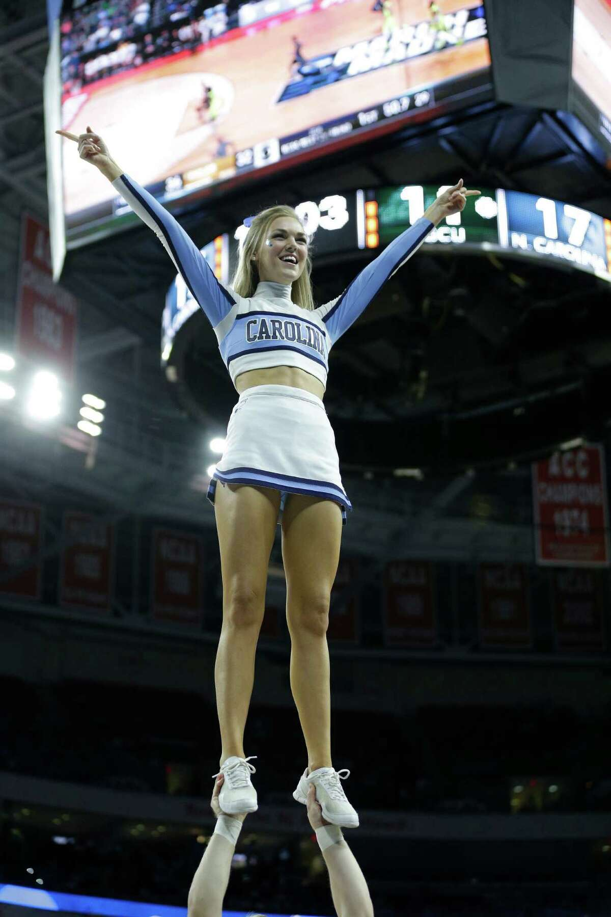 North Carolina cheerleaders perform during the first half of a first-round men's college basketball game in the NCAA Tournament between Southern California and Providence, Thursday, March 17, 2016, in Raleigh, N.C.
