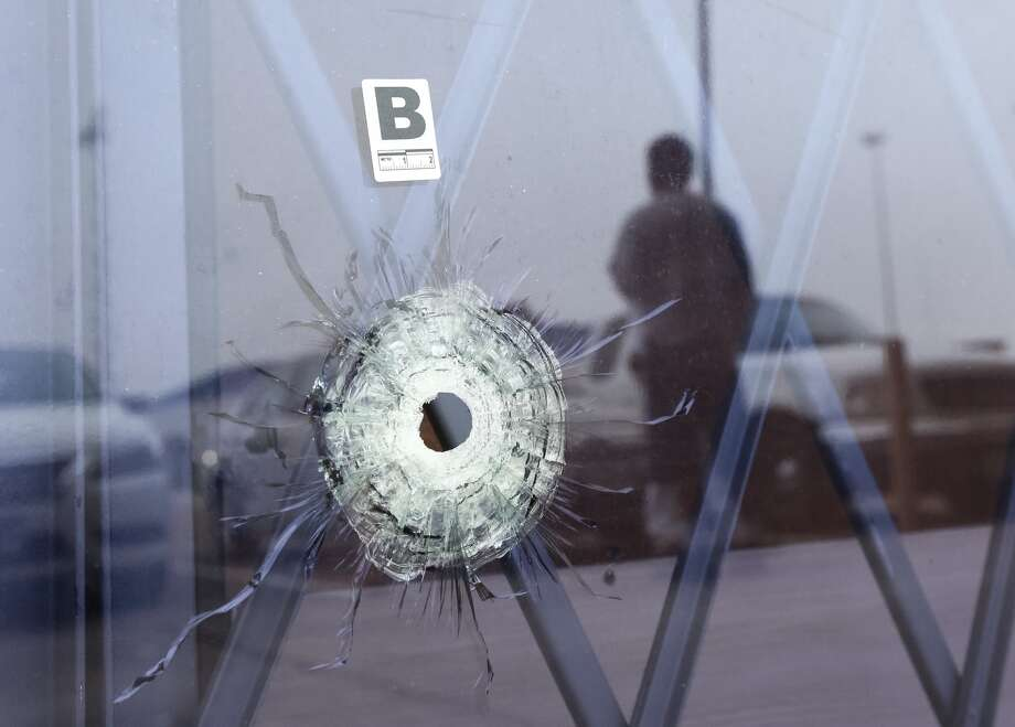 A bullet hole is seen at an Affordable Furniture store in the 11300 block of the North Freeway, the morning after Houston police shot and killed two people and injured a third when they confronted a group of five men during an alleged robbery.
