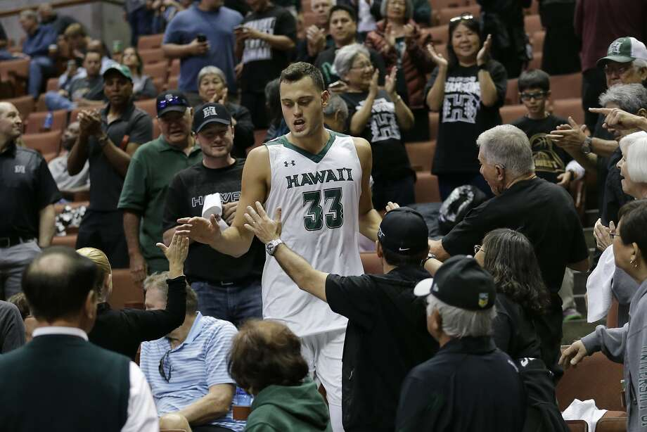Hawaii forward Stefan Jankovic greets fans after an NCAA college basketball game against Cal State Fullerton in the Big West Conference tournament Thursday, March 10, 2016, in Anaheim, Calif. (AP Photo/Gregory Bull) Photo: Gregory Bull, AP