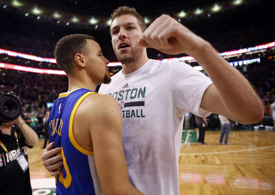 Golden State Warriors' Stephen Curry talks to Boston Celtics' David Lee after Warriors 124-119 double overtime win in NBA game at TD Garden in Boston, Massachusetts on Friday, December 11, 2015. Photo: Scott Strazzante, The Chronicle