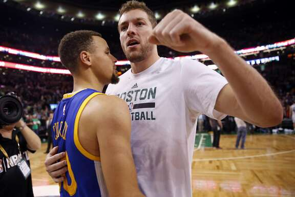 Golden State Warriors' Stephen Curry talks to Boston Celtics' David Lee after Warriors 124-119 double overtime win in NBA game at TD Garden in Boston, Massachusetts on Friday, December 11, 2015.