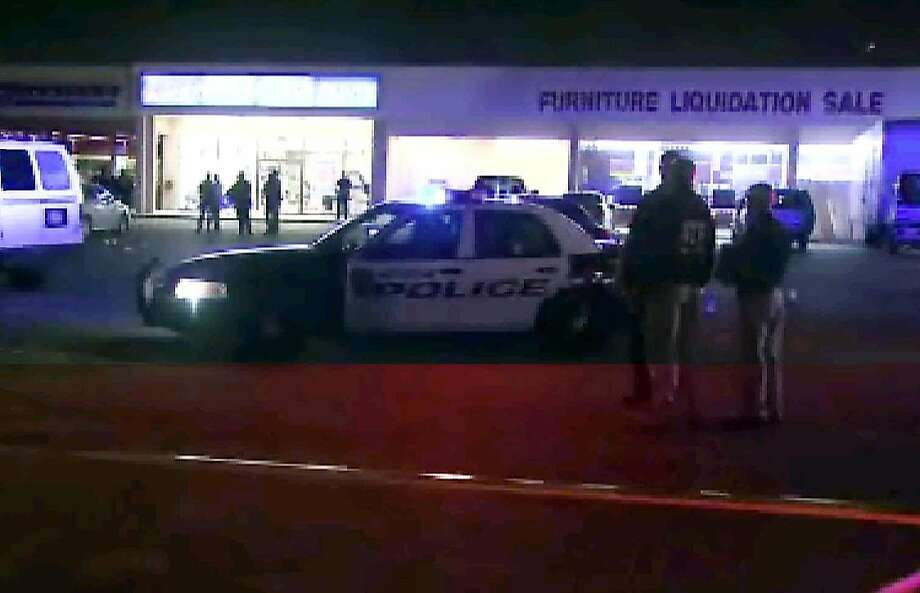 This still image taken from video provided by KPRC shows police responding to the scene of the shooting Thursday in Houston. Police fired at five suspects. Photo: AP