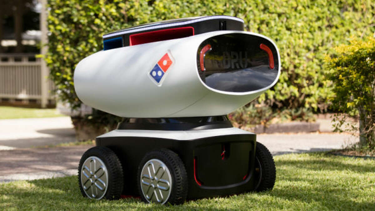 This cute droid delivers piping hot pizzas to your door Domino's announced it's testing an autonomous pizza delivery robot in New Zealand on March 18, 2016. The short and squat droid, who looks like a cross between a Wall-E and an R2D2, can carry up to 10 pizzas.
