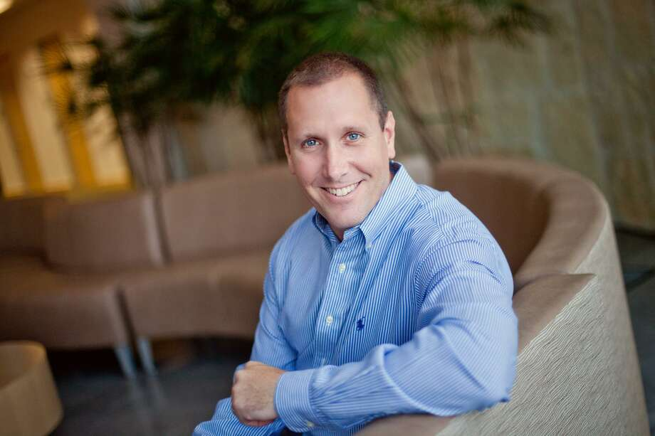 Rackspace Hosting CEO Taylor Rhodes said he is leaving the San Antonio managed cloud company to join a smaller private company in another city. Photo: Courtesy Photo