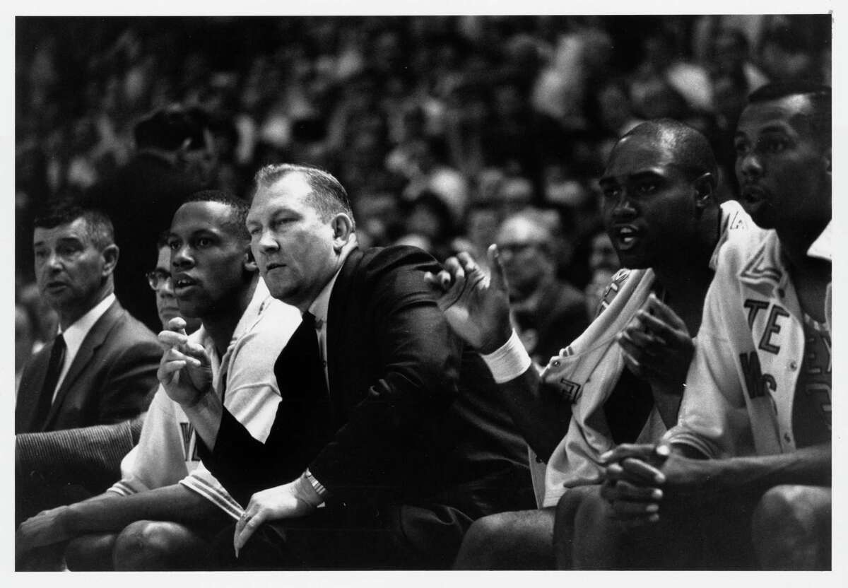 Texas Western coach Don Haskins and one of his players, William Cager, cheer on the Miners during the second game of the NCAA championship playoffs at the Univ. of maryland. The Miners defeated Utah, 85-78. March 18, 1966. HOUCHRON CAPTION (02/06/2000): Haskins leans into Cager while Lattin and Shed, right, cheer the Miners during the second game of the '66 NCAA tournament semifinals, when Texas Western defeated Utah.