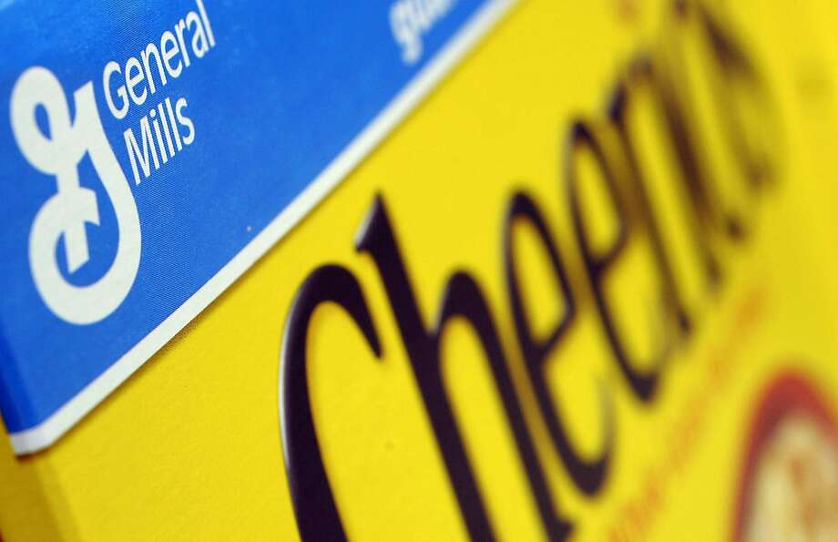 FILE - In this Dec. 15, 2007 file photo, a box of General Mills' Cheerios is seen on a shelf at a Shaw's Supermarket in Gloucester, Mass.  General Mills says it will start labeling products across the country that contain genetically modified ingredients to comply with a law that is set to go into effect in Vermont. The maker of Cheerios cereal, Progresso soups and Yoplait yogurt notes it is impractical to label its products for just one state, so the disclosures required by Vermont starting in July 2016 will be on its products throughout the U.S. (AP Photo/Lisa Poole, file) Photo: Lisa Poole, AP