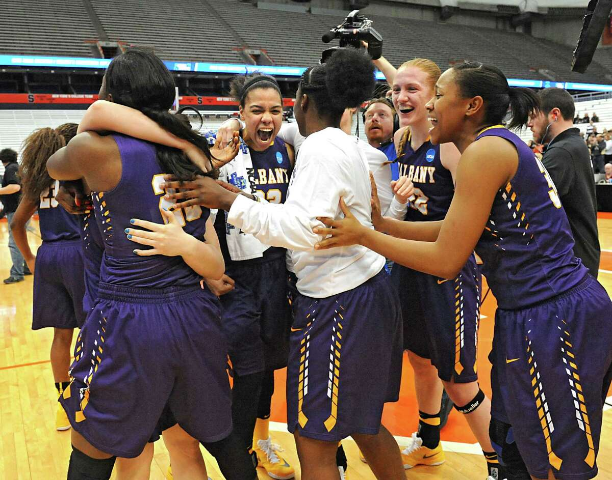 University at Albany players celebrate in a victory against Florida in the first round of the NCAA women's basketball tournament at the Carrier Dome on Friday, March 18, 2016 in Syracuse, N.Y. (Lori Van Buren / Times Union)