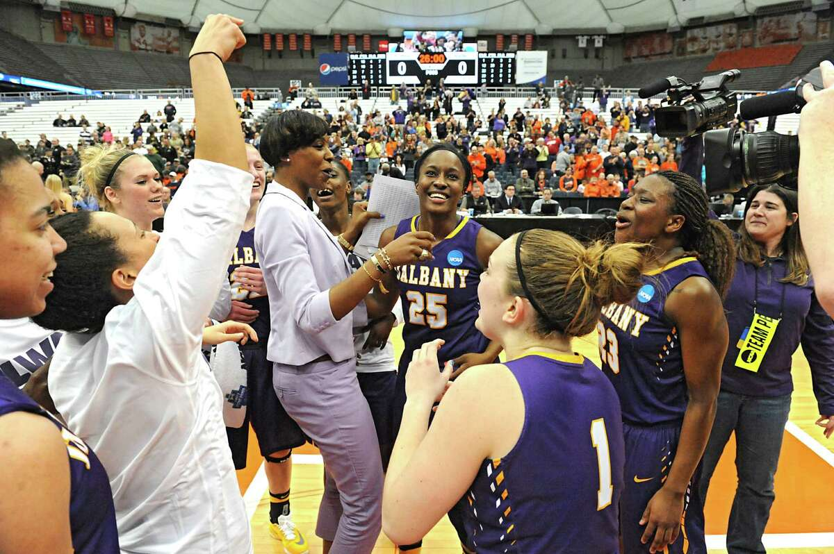 University at Albany players and coaches celebrate in a victory against Florida in the first round of the NCAA women's basketball tournament at the Carrier Dome on Friday, March 18, 2016 in Syracuse, N.Y. (Lori Van Buren / Times Union)