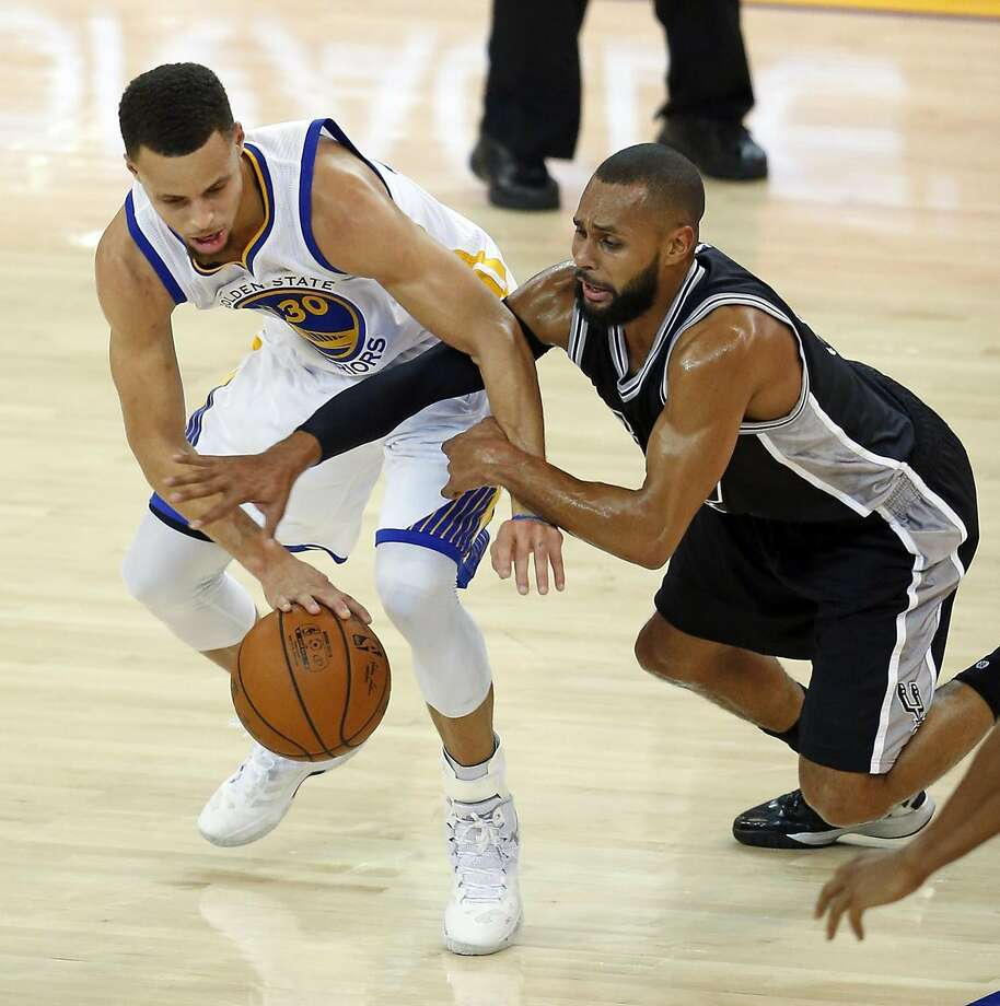 Golden State Warriors' Stephen Curry is fouled by San Antonio Spurs' Patty Mills in 1st quarter during NBA game at Oracle Arena in Oakland , Calif., on Monday, January 25, 2016. Photo: Scott Strazzante, The Chronicle