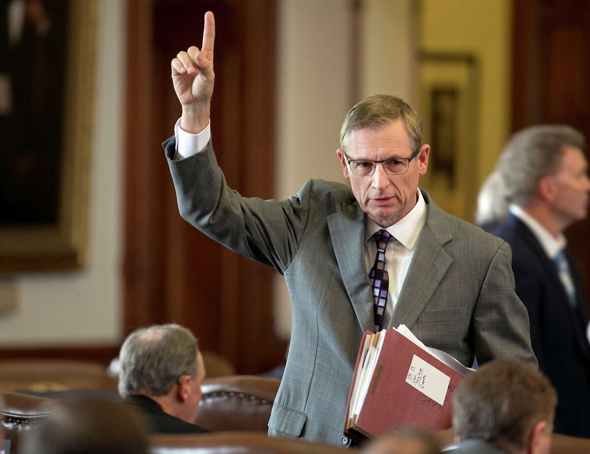 State Rep. Byron Cook votes on a comprehensive ethics bill in the House during the 84th Legislature. Ethics reform collapsed after the House and Senate disagreed on whether to require disclosure of anonymous donors to politically active nonprofits.