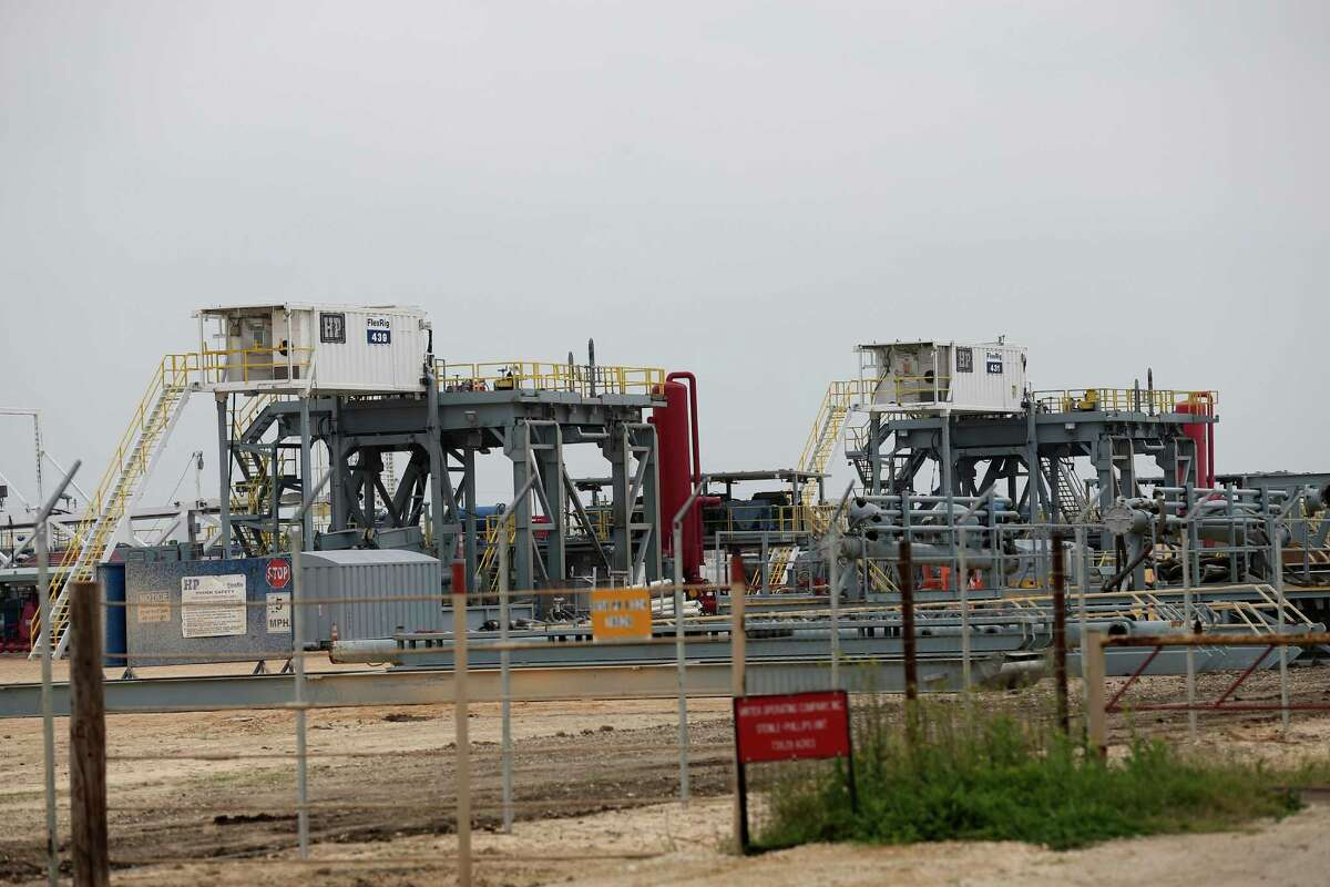 H&P drilling platforms sit idle at a yard along State Highway 16 south of Jourdanton, Texas, Tuesday, March 8, 2016.