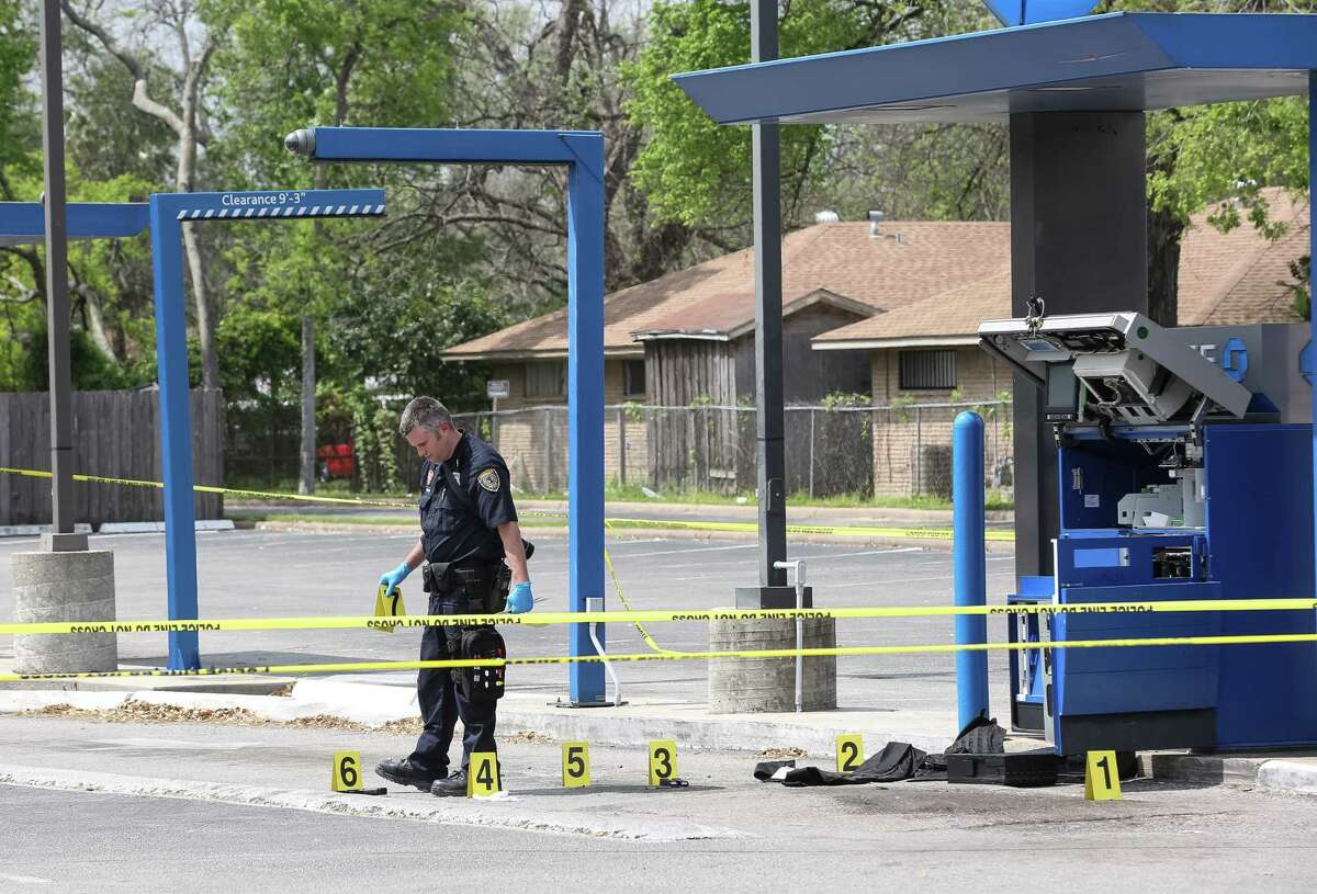 A driver of an armored truck was shot at least once during a robbery at a Chase Bank in north Houston, Friday, March 18, 2016.