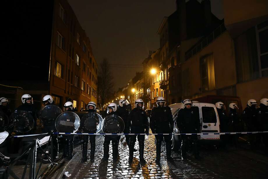 Belgian police forces stand guard in a street during a police action in the Molenbeek-Saint-Jean district in Brussels, on March 18, 2016. A police operation was underway on March 18, in the Brussels area home to key Paris attacks suspect Salah Abdeslam whose fingerprints were found in an apartment raided this week, the federal prosecutor's office said. Photo: John Thys, AFP/Getty Images