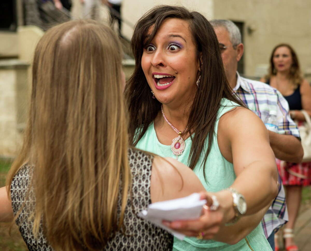 Lorena Do Val, right, reaches out to embrace Meredith Liebl after opening their residency assignment envelopes during Match Day ceremonies at the McGovern Medical School at UTHealth on Friday, March 18, 2016, in Houston. The more than 200 UTHealth medical students found out where they will do their residency, as part of the results of the National Resident Matching Program.