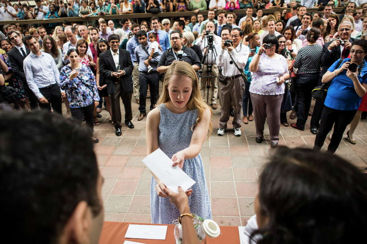 Medical students pick up their residency assignment envelopes during Match Day ceremonies at the McGovern Medical School at UTHealth on Friday, March 18, 2016, in Houston. The more than 200 UTHealth medical students found out where they will do their residency, as part of the results of the National Resident Matching Program.