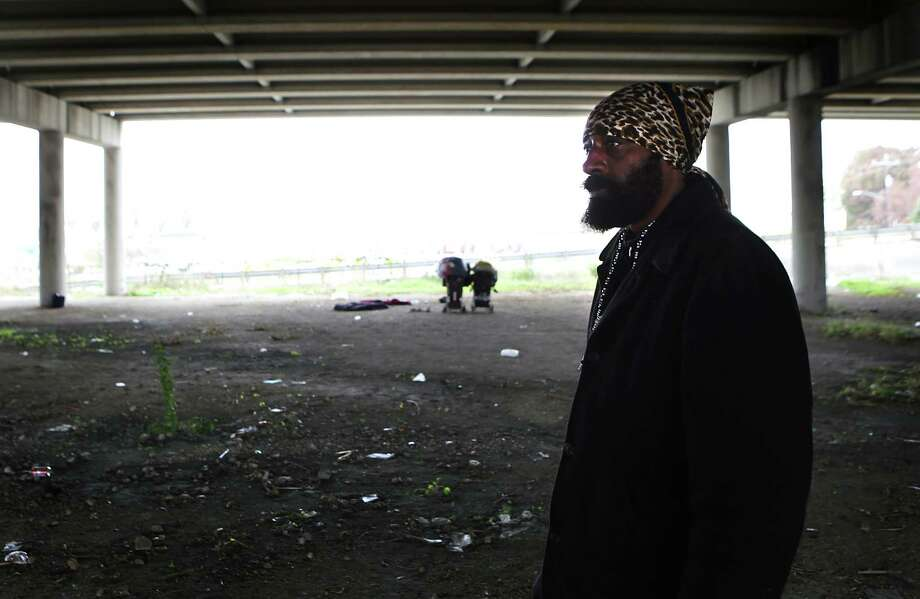 A homeless man who said he is a veteran walks under Interstate-37 in downtown San Antonio. Photo: BOB OWEN /San Antonio Express-News / San Antonio Express-News