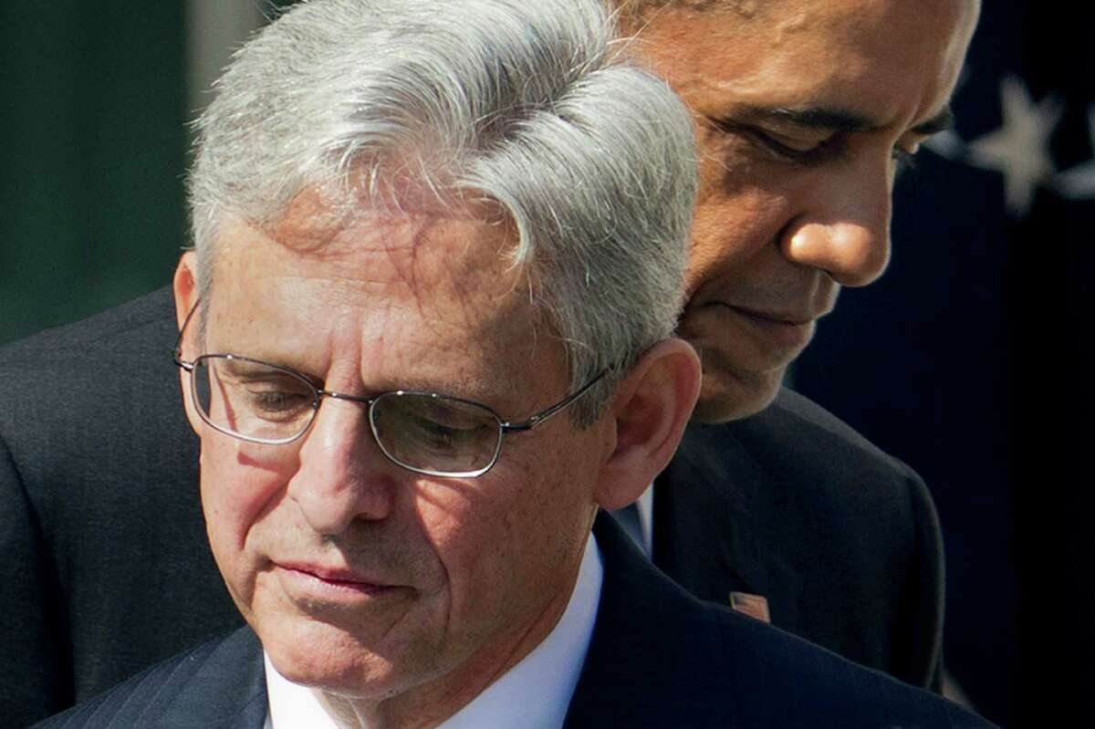 Federal appeals court judge Merrick Garland, with President Barack Obama as he is introduced as Obama's nominee for the Supreme Court during an announcement in the Rose Garden of the White House. The Senate should give Garland a confirmation hearing and up-or-down vote.