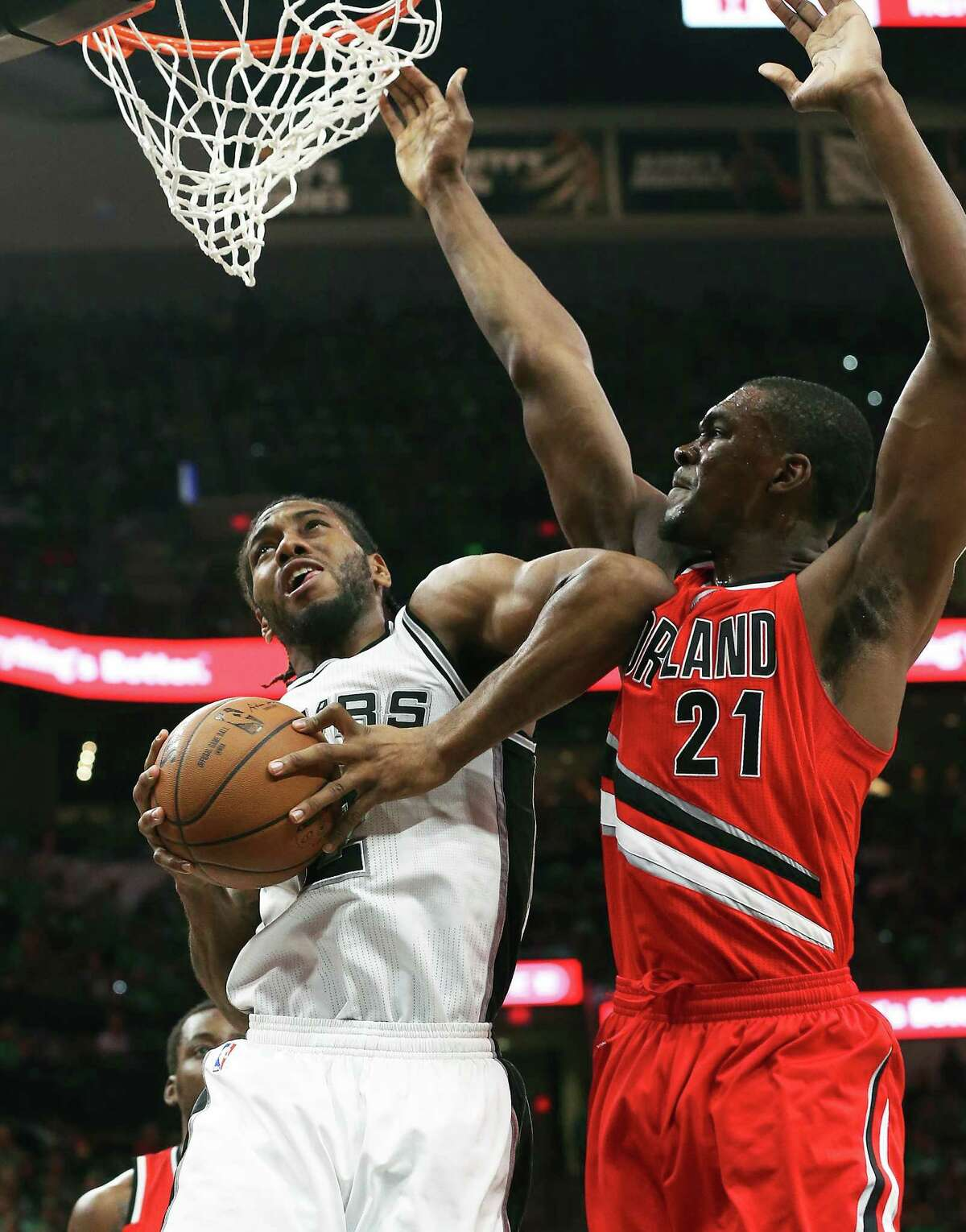 Kawhi Leonard uses some leverage on Noah Vonleh to score in the first half as the Spurs host the Blazers at the AT&T Center on March 17, 2016.