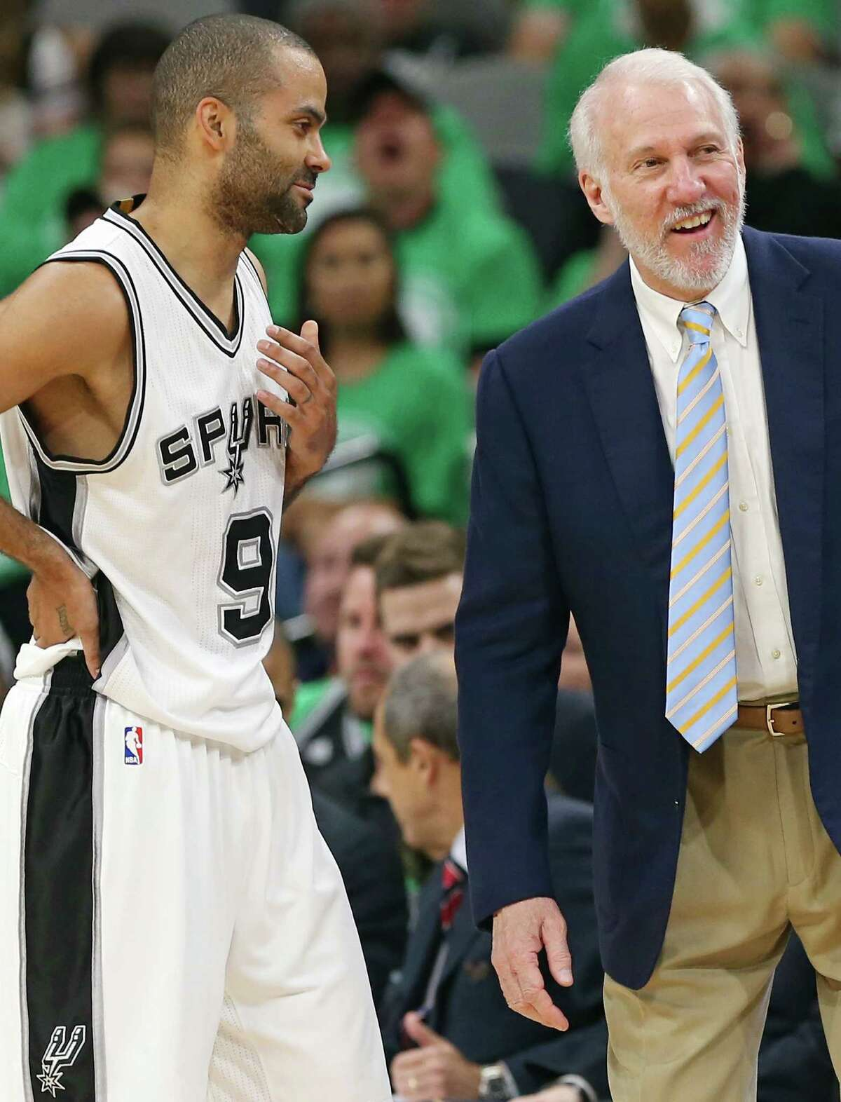 San Antonio Spurs' Tony Parker talks with head coach Gregg Popovich during second half action against the Portland Trail Blazers Thursday March 17, 2016 at the AT&T Center. The Spurs won 118-110.